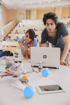 Two students working on an HP Notebook in class