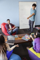Young professionals collaborate at the office